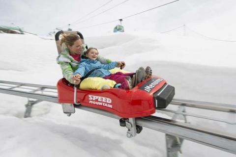 Mother and child on a toboggan