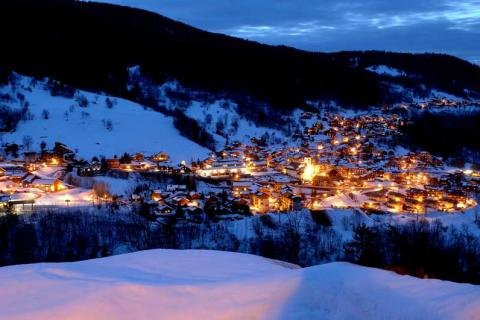 Meribel village lit up at night