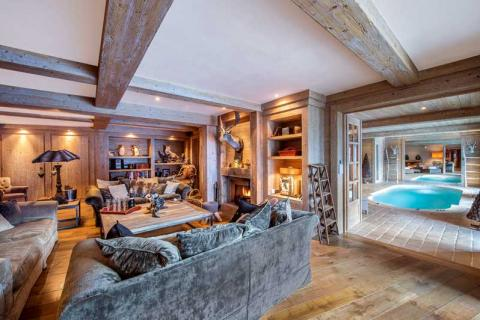 Inside of a luxury chalet in Meribel with an indoor pool