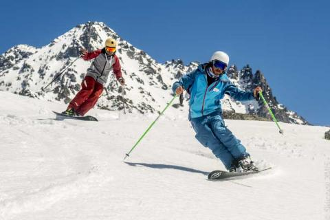 Two skiers on the slopes in Val Thorens