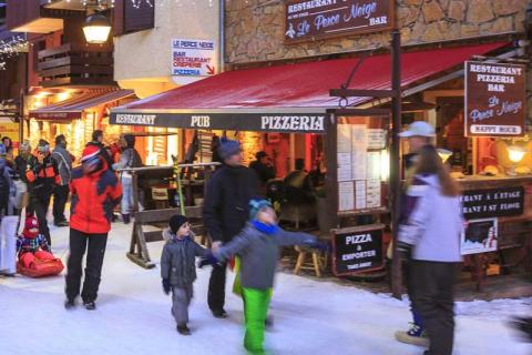 People standing outside a pizza restaurant in Valmorel