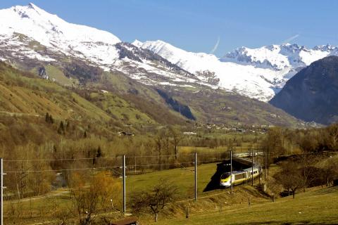 Photo of a Eurostar train winding its way through the Alps