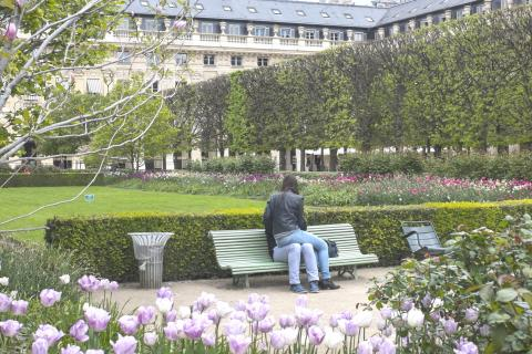 Couple on a bench with girl sitting on the guy's knee