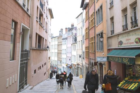 People walking on a steep street in Lyon's old town
