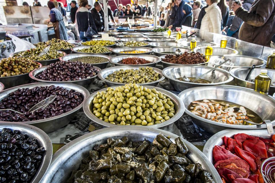 bowls of olives, pickles and other food at the Exotic Market in Antwerp