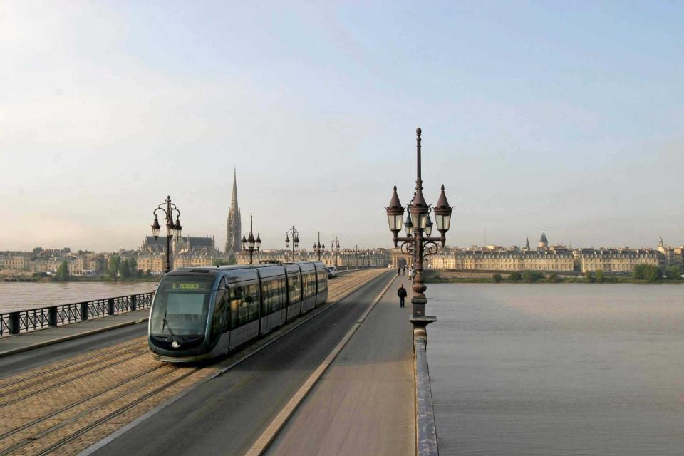 Tram crossing a bridge in Bordeaux