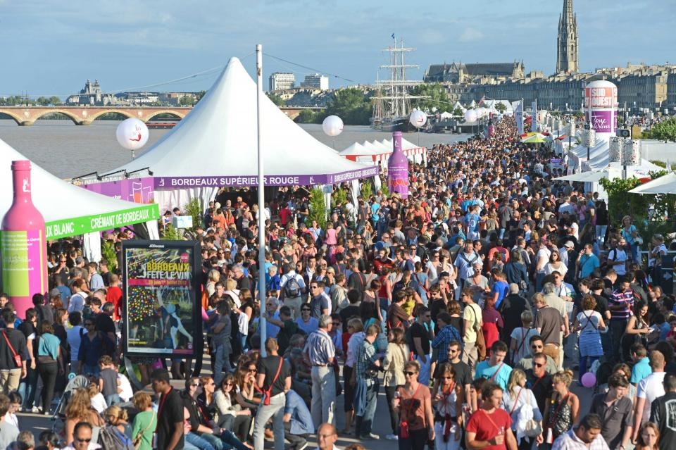 Crowds of people at the Bordeaux wine festival on the river bank