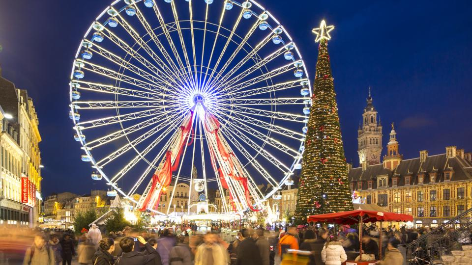 The Ferris wheel and Christmas tree on the Grand Place in Lille