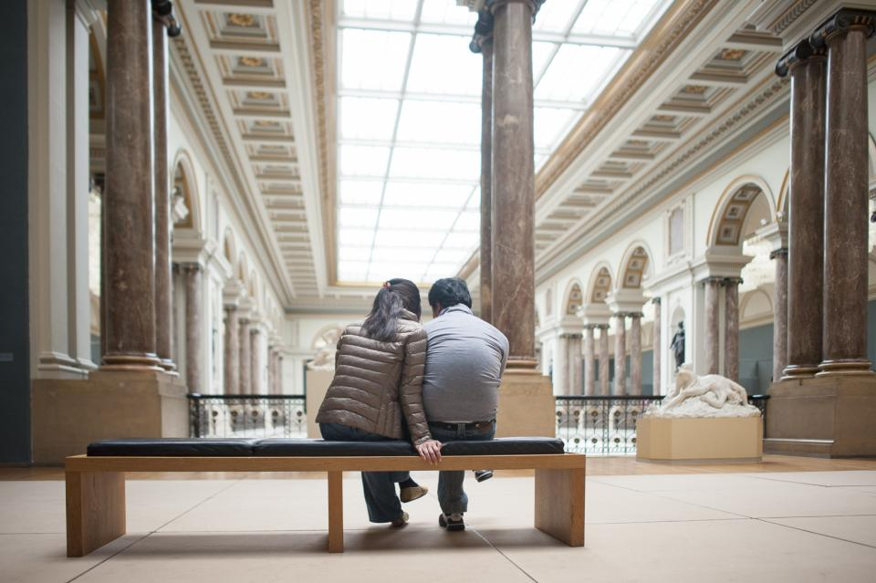 Couple sitting on a bench inside the Fine Arts Museum, Brussels