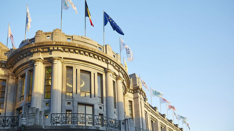 Flags flying on the roof of the BOZAR building